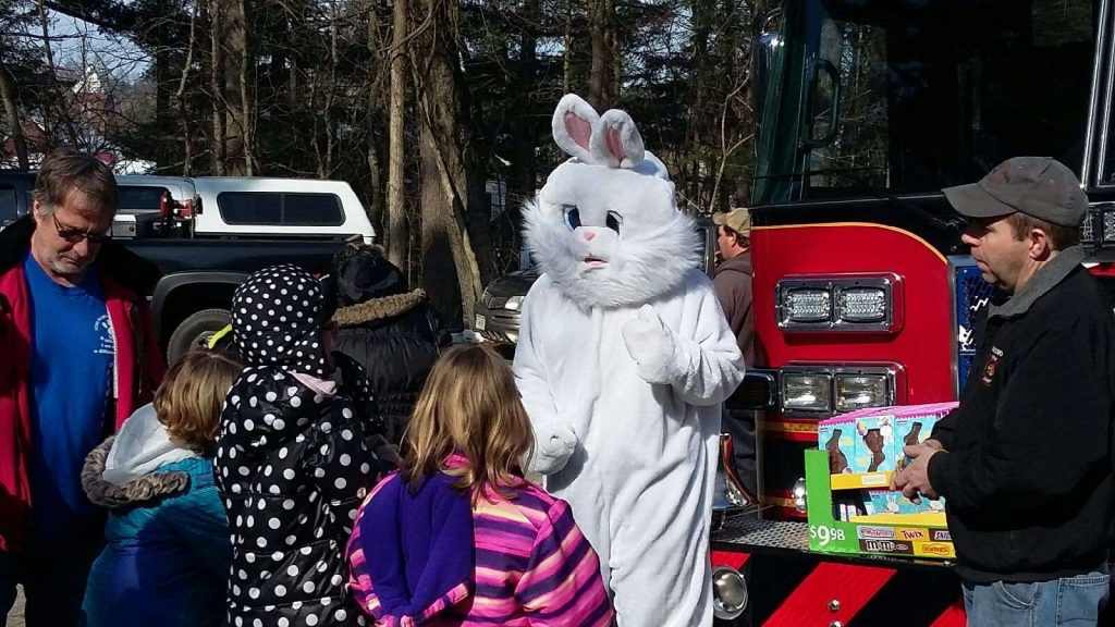 Easter Bunny passing out treats.